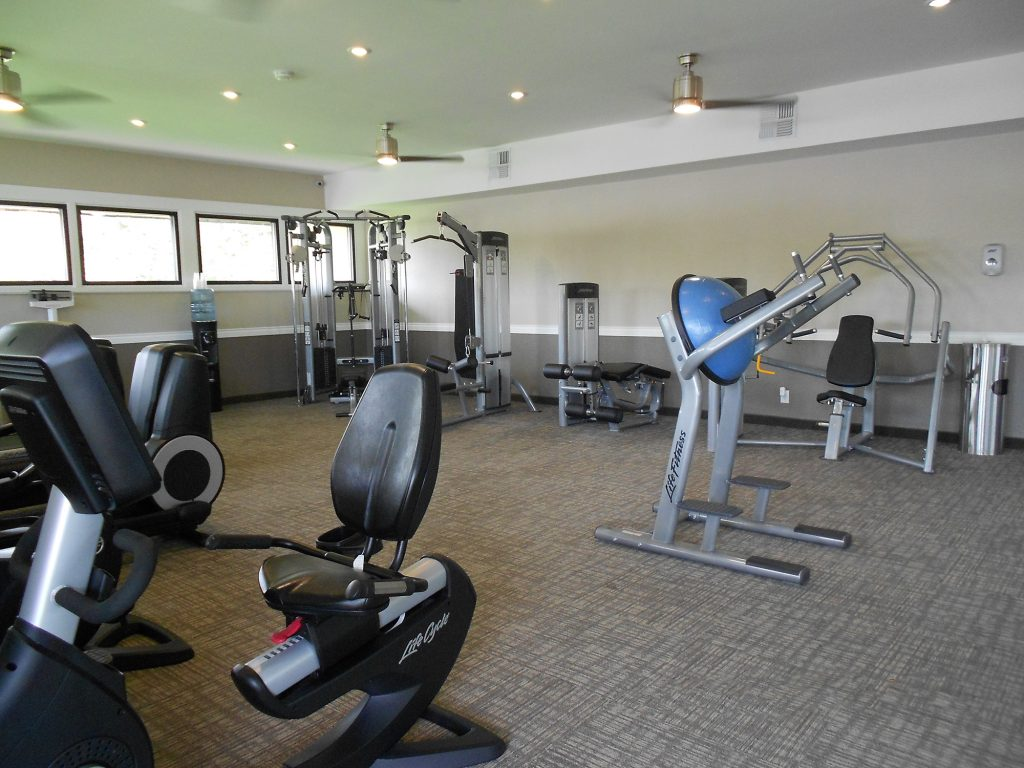 State of the art fitness center with stationary bikes and weight machines.
