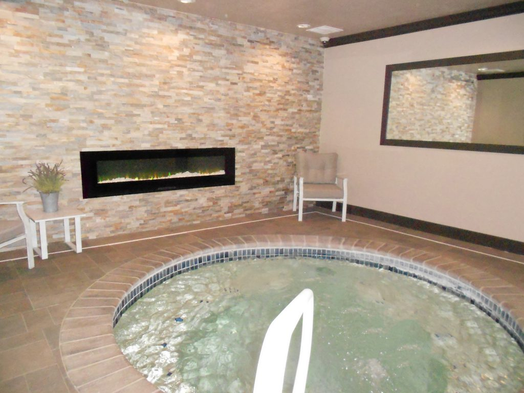 Indoor spa with gas fireplace.