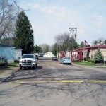 This manufactured home community has wide clean paved streets. Cars can park on the street outside their home.