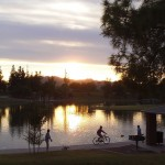 Gorgeous sunset at the lake while people walk and bike in Tempe Arizona