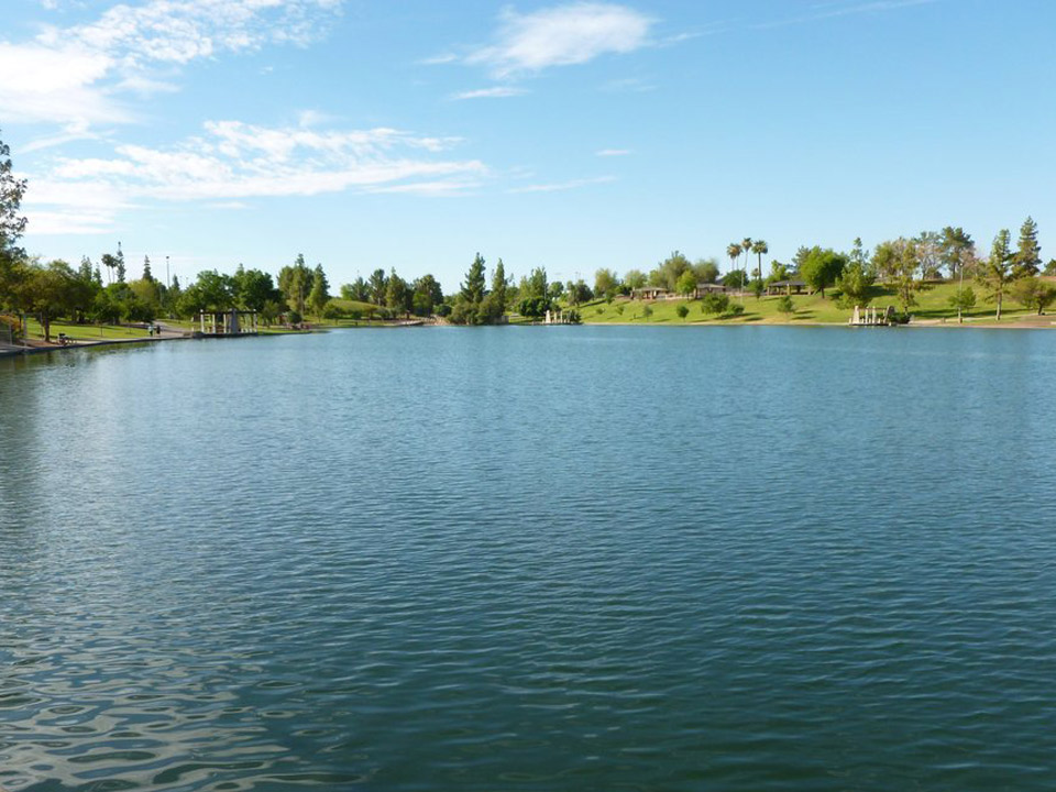 Beautiful, clean, peaceful lake with surrounding lush hillsides