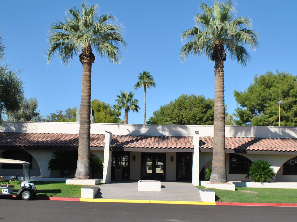 Chaparral Village in Tempe Arizona has a welcome center with two tall palm trees out front of it.