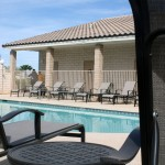 Cimarron Trails, a 55 plus manufactured home community in San Tan Valley Arizona offers comfortable lounge chairs around the pool.