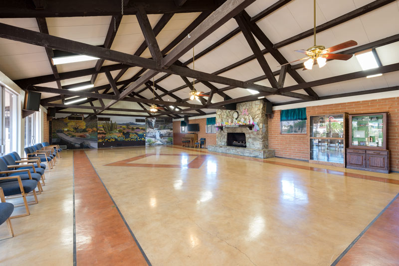 Large, open community center space with high vaulted ceilings. Space for residents to host events or community activities.