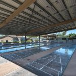 Covered shuffleboard court with four different boards to use. Clean and paved area throughout.
