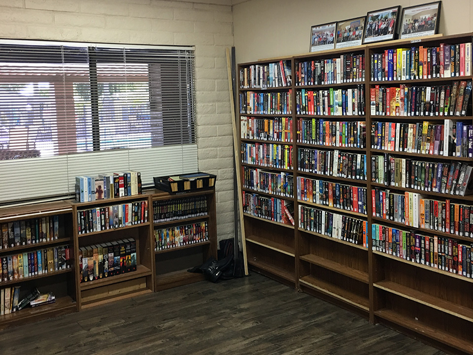 Library with 3 tall and 3 short bookcases filled with books to read.