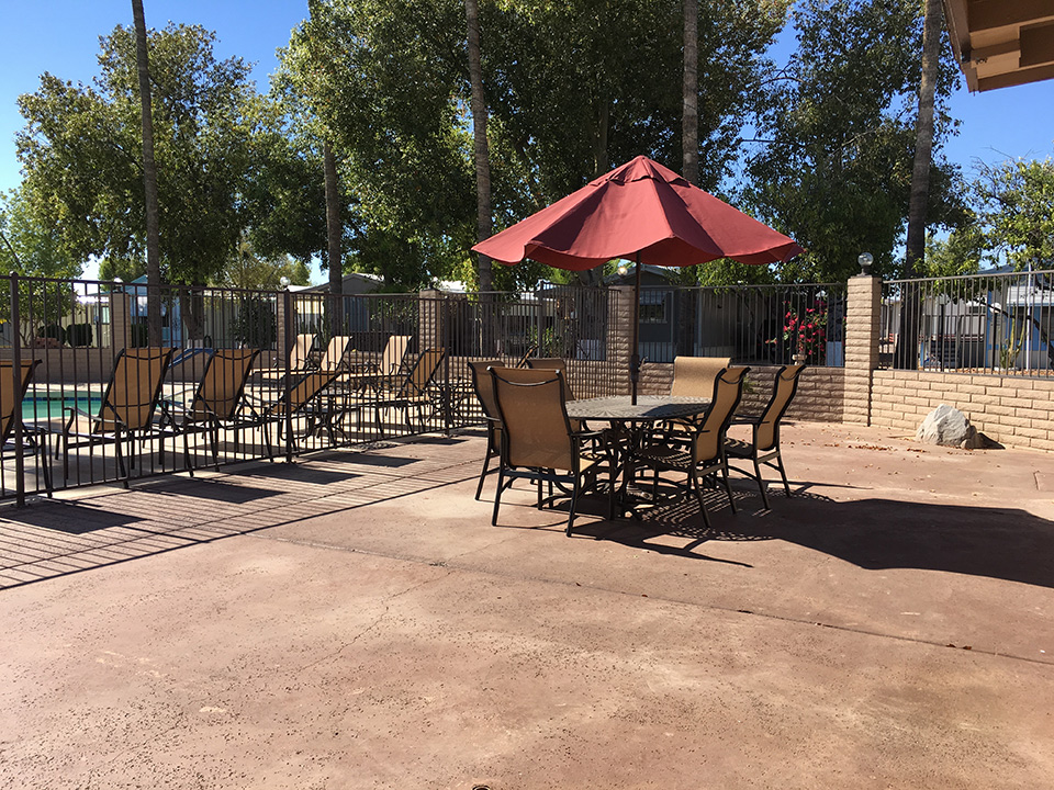 Large outdoor patio with patio table and chairs and umbrella to keep you cool.