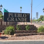 Pueblo Grande, a 55 plus community, sign on corner of entrance into community off the street.