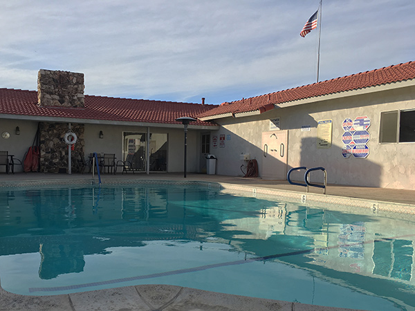 Large outdoor pool behind the community center for residents to enjoy with friends and family.