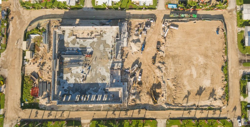 Aerial shot from above the clubhouse in the midst of being built. Full view of the top and the large, open back end, which will serve as space for multiple outdoor activities.