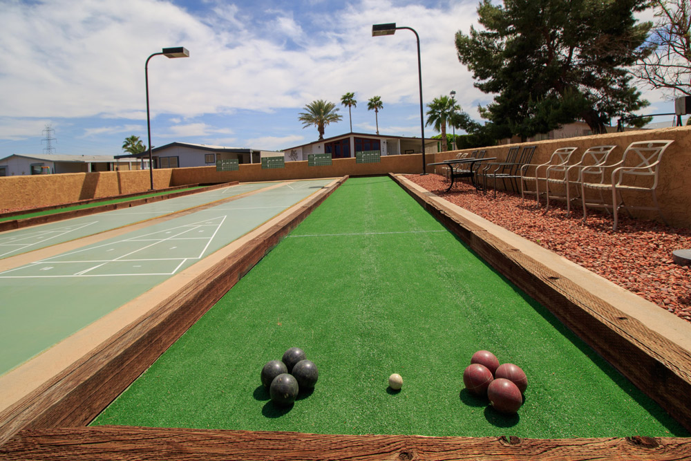 Boccee Ball Court with 2 sets of bocce-balls displayed and shuffleboard court to the left