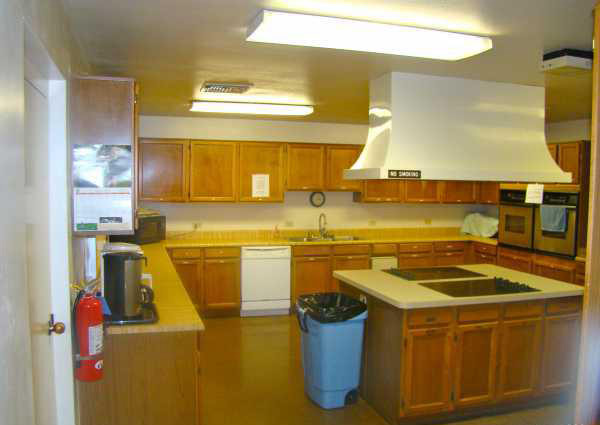 Clubhouse with kitchen. Features 2 stoves, 2 ovens, dishwasher, microwave and plenty of wood cabinets.