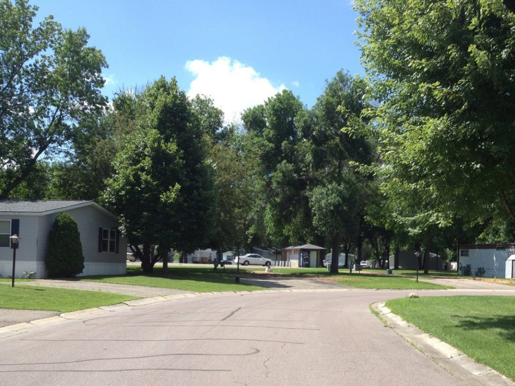 Clean, paved roads throughout the community along with tall, lush trees.