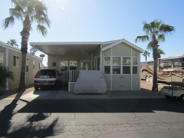 View 651-6921-972 2012 CAVCO FULLY FURNISHED ARIZONA ROOM WITH LARGE DECK 1 3/4 BATH GREAT LOCATION VIN# 46NPA3438C4001141