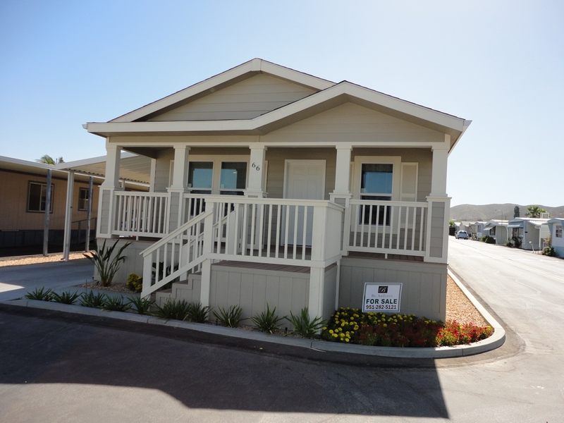 Beautiful, brand new beige and creme home on corner lot for sale. Covered front porch with small set of stars.