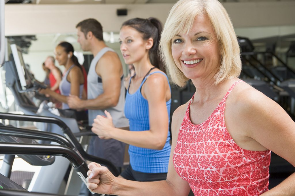 Group of people enjoying their workout at the fitness center at Holiday Palms, a 55 plus community, in Mesa Arizona.