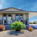 Our manufactured homes come often with covered porches and a carport. And with low maintenance yard work