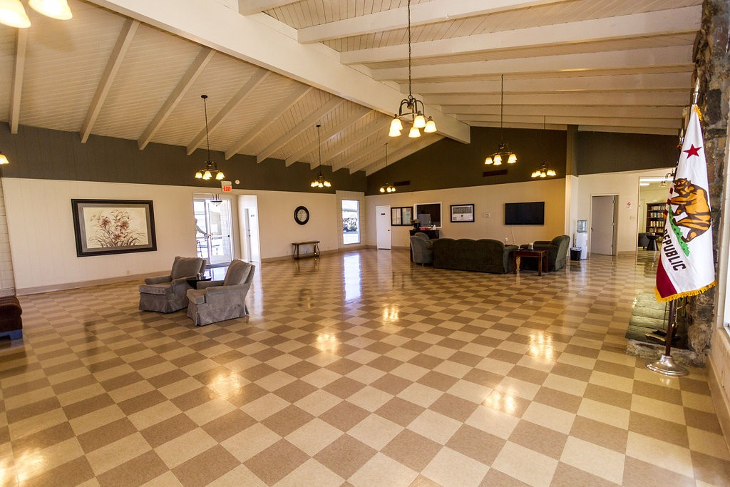 Large Community hall provides access to outdoor lounge area leading to outdoor community pool.