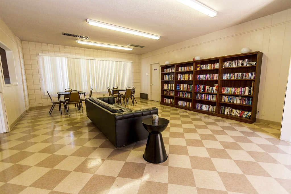 Resident library within the community hall. Provides a large bookcase filled with novels and a space to sit, read, and relax.