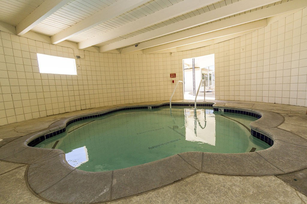 Indoor spa open to all residents. Available space for multiple users to sit and relax.
