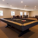 One of the three pool tables within the Billiard room. Inclusive for all residents to enjoy.