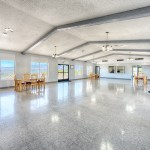 Large clubhouse with tall vaulted ceiling and wide open space to host events. Beautiful view of skyline to downtown Reno and mountains.