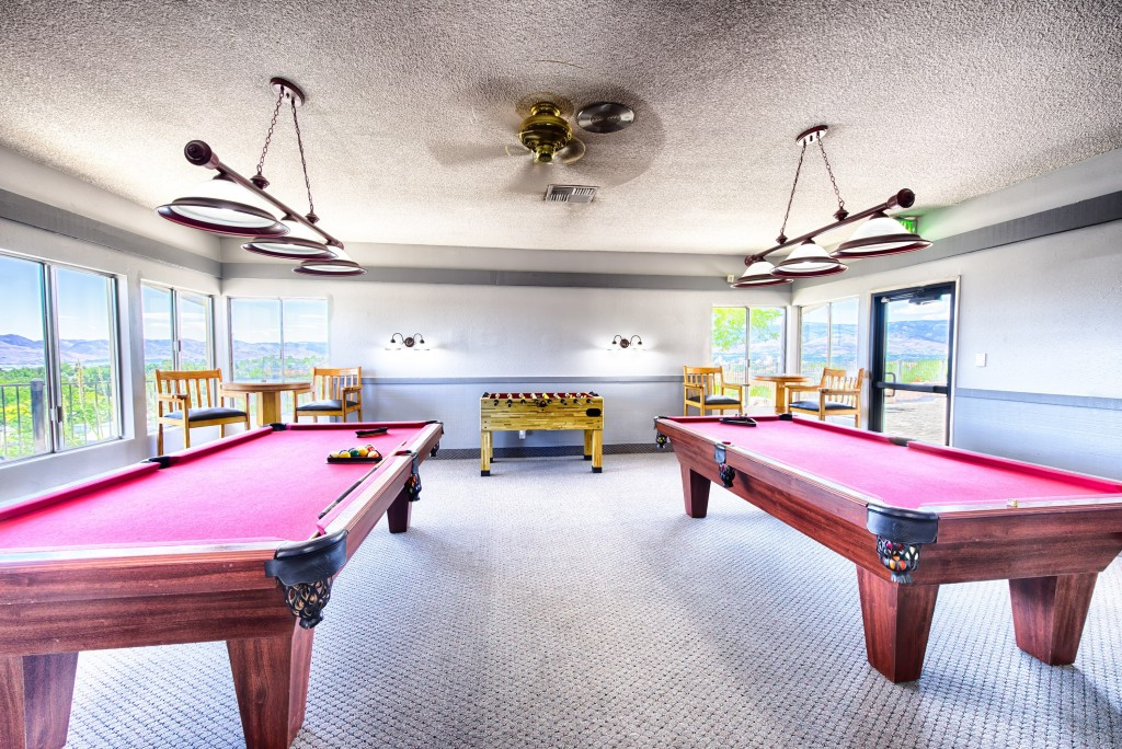 For activities, a game room with pool tables, foosball, and bar stools and tables to sit at. Beautiful views of the city and mountains through the windows.