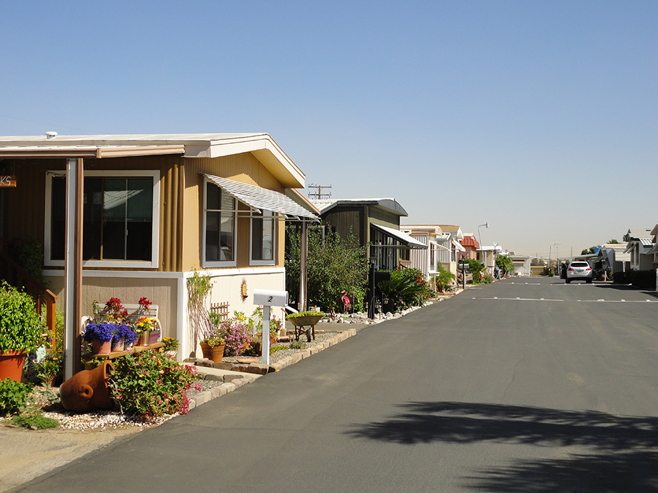 Manufactured home community with peaceful neighborhood and landscaped yards. Wide, clean, paved streets.