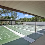 Island in the Sun, an active 55+ manufactured home community, has 6 shuffleboard courts. There is covered seating.