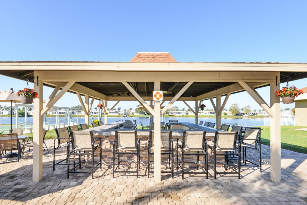 Large covered BBQ and patio area located outside off the lake.