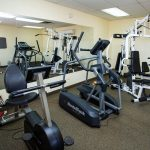 Fitness Room with universal weight machines, stationary bike and a elliptical machine