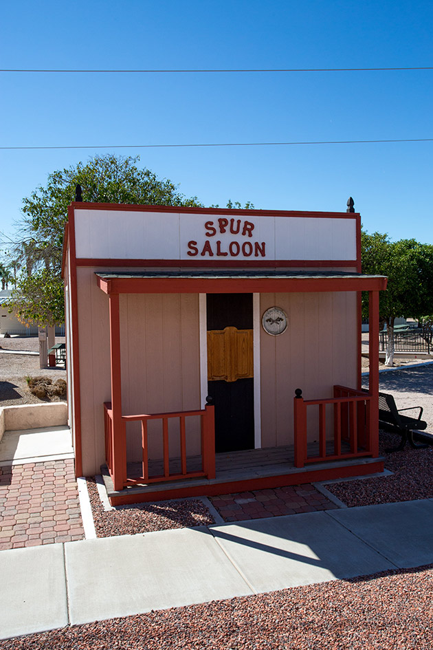 A Spur Saloon made of wood looks like the real thing and is on display.