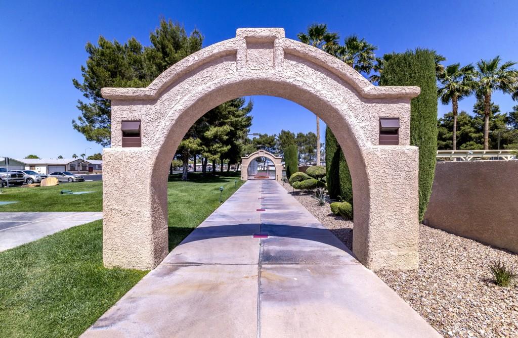 A pathway under stone archways.