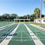 Three clean, fresh paved shuffleboard courts.