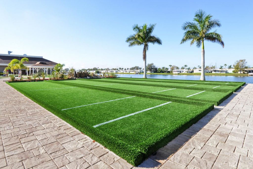 Clean bocce ball fields by the lake