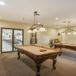 A game room with pool tables.