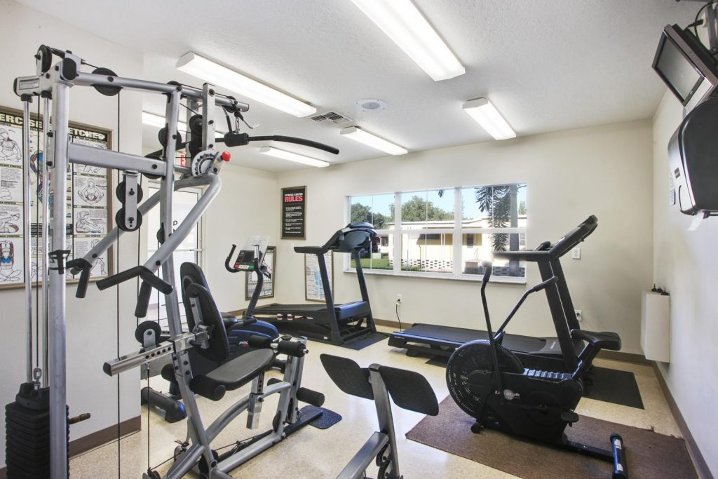 Brand, new fitness center with treadmills, weight machine and stationary bike.