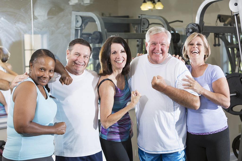 Multi-ethnic group of mature men and women (50s, 60s) staying fit, at the gym