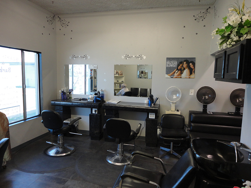 The on-site hair salon equipped with salon chairs for washing, cutting, styling, and blow-drying hair.