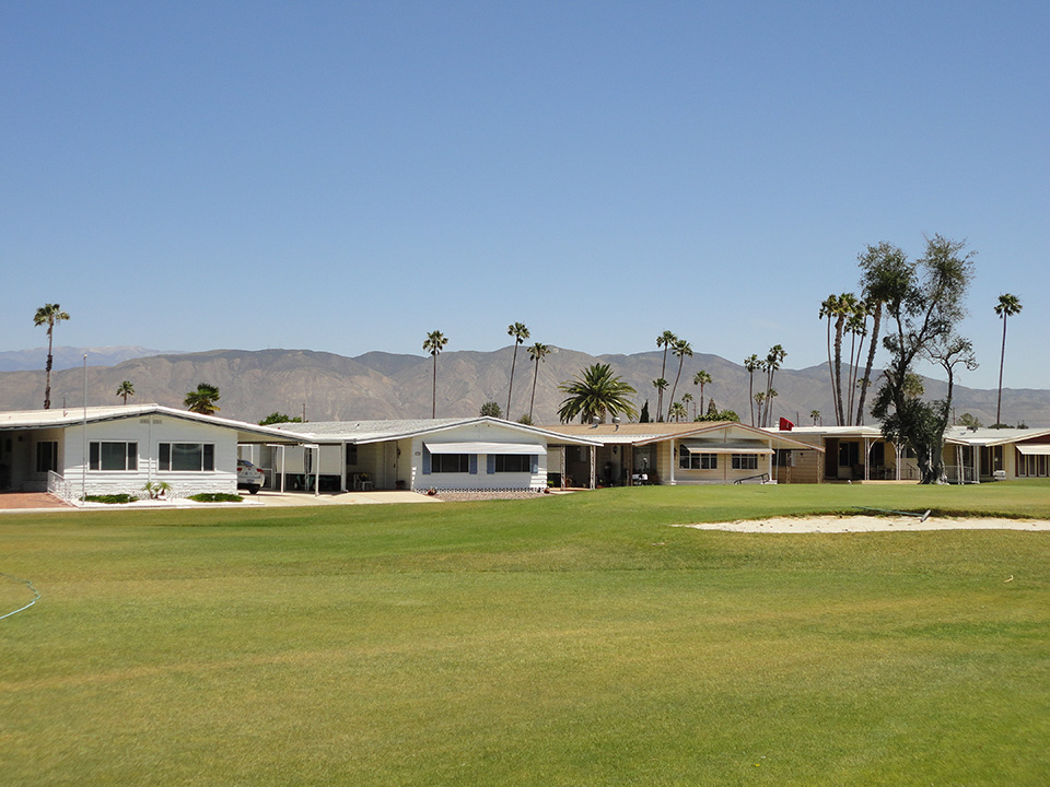 Beautiful, green golf course surrounding the multiple manufactured homes in the 55+ community. Residents have the luxury of two beautiful views, that of the mountains and of the golf course.