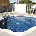Large, updated hot tub for residents use to relax. Adjacent to the heated pool and outdoor shower to wash off after the pool.