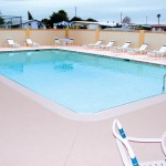 Outdoor heated pool opened to all residents year-round. Surrounded by lounge chairs for residents to sit and relax.