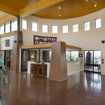 Community center with very high ceilings with Montesa at Gold Canyon offices side by side. Smooth floors.