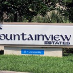 Sign labeling Fountainview Estates, a 55 + community, at the entrance.