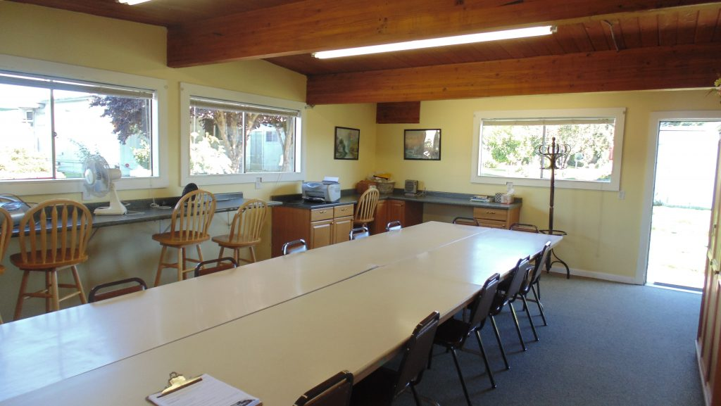 Community crafts room equipped with various arts and crafts for residents to enjoy. Multiple seating and table space.