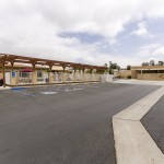 Large, open parking lot at the entrance of the community center. Easy access to the community center, the outdoor pool, and entrance into the community.