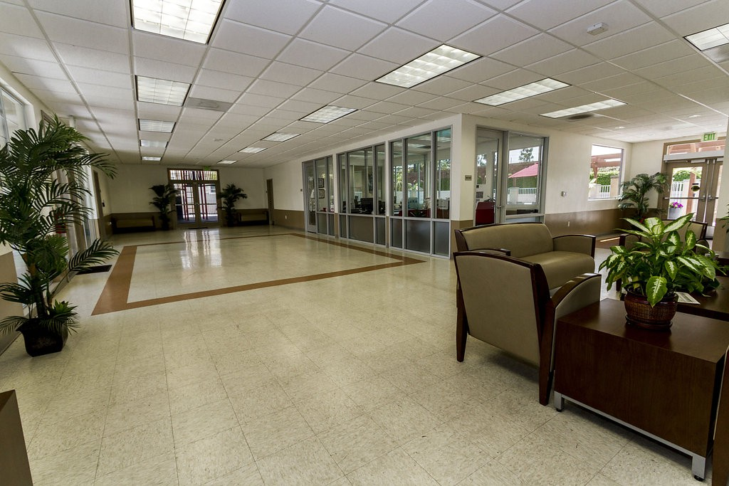Large, open community center connected to the leasing office. Light linoleum flooring throughout and space for activities, hosting of parties, and much more.