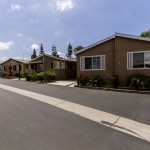 Street view of Orange Mobile Home Park, a family friendly community, with wide, clean streets, and beautiful manufactured homes.