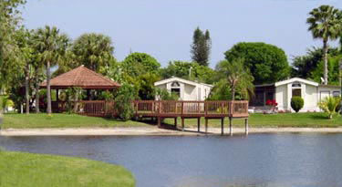 Palm Beach Plantation is an all age manufactured home community with a beautiful 5 acre lake. Some homes back right up to the lake. A gazebo with covered seating has a long dock extends into the lake