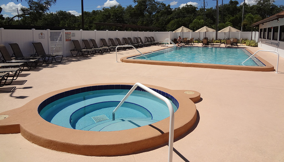 A spa sits near pool.